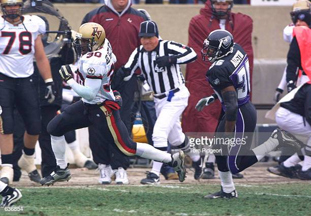 Running back Rod Smart of the Las Vegas Outlaws wearing the name 'He Hate Me' on his jersey runs for a first down past defender Ray Austin of the...
