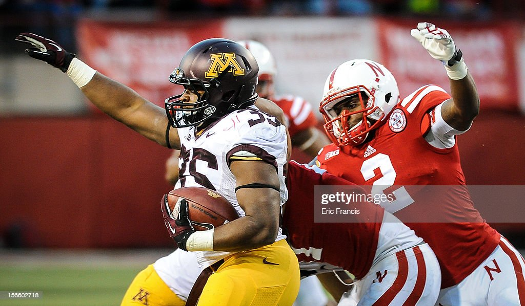 Running back Rodrick Williams Jr. #35 of the Minnesota Golden Gophers tres to find the edge past defensive back Corey Cooper #2 of the Nebraska Cornhuskers during their game at Memorial Stadium on November 17, 2012 in Lincoln, Nebraska. Nebraska won 38-14.