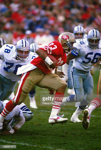 Running Back Roger Craig of the San Francisco 49ers breaks the arm tackle of John Dutton of the Dallas Cowboys during an NFL football game December...