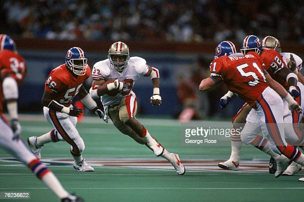 Running back Roger Craig of the San Francisco 49ers looks for room to run against Denver Broncos inside linebacker Marc Munford in the second quarter...
