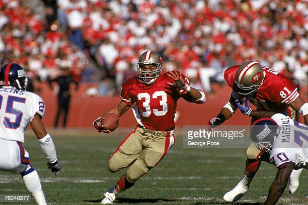 Running back Roger Craig of the San Francisco 49ers looks for room to run during the 1990 NFC Championship game against the New York Giants at...