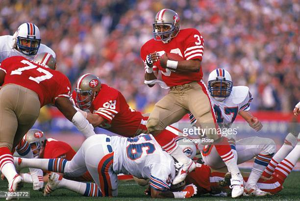 Running back Roger Craig of the San Francisco 49ers runs for two yards on a 1st and 10 at the 49ers 36 yard line in Super Bowl XIX against the Miami...