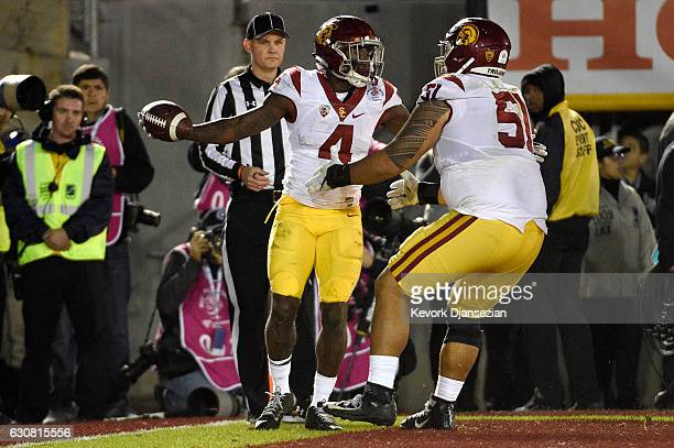 Running back Ronald Jones II of the USC Trojans celebrates with guard Damien Mama after scoring a touchdown in the fourth quarter against the Penn...