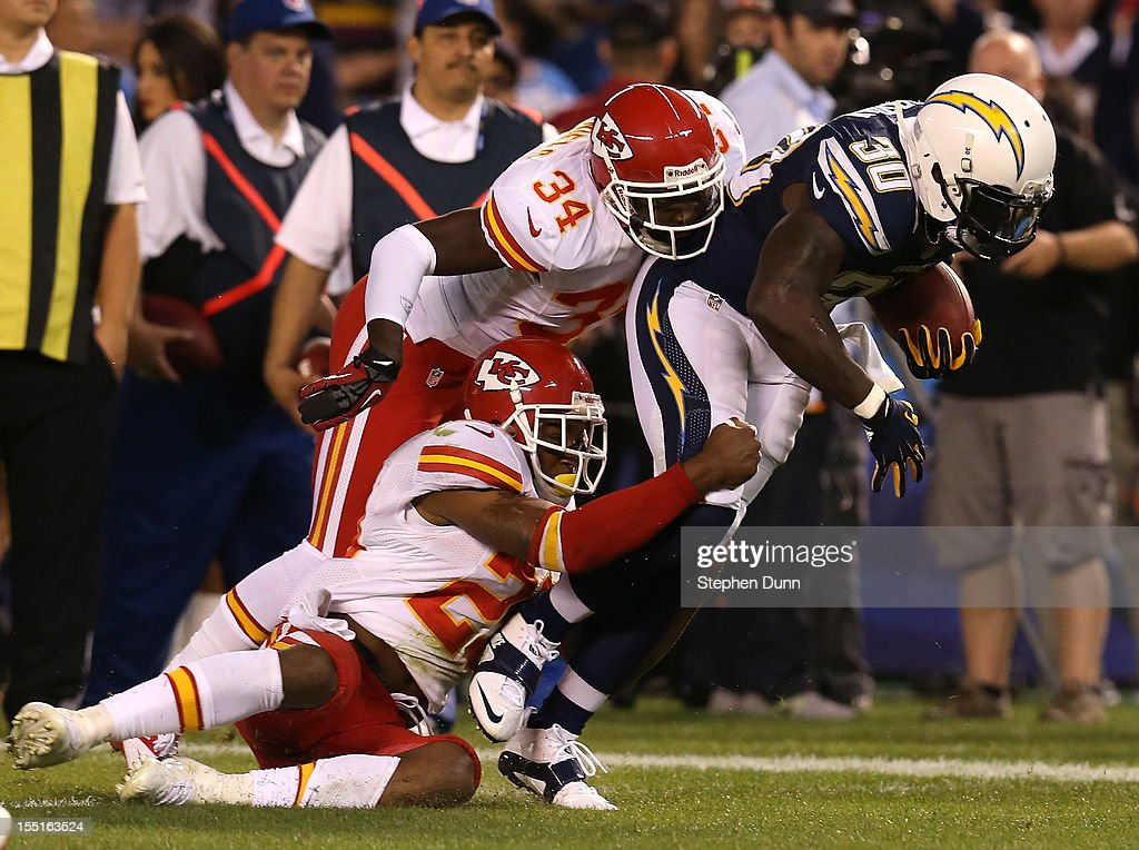 Running back <a gi-track='captionPersonalityLinkClicked' href=/galleries/search?phrase=Ronnie+Brown&family=editorial&specificpeople=228574 ng-click='$event.stopPropagation()'>Ronnie Brown</a> #30 of the San Diego Chargers carries the ball against defensive backs Travis Daniels #34 and <a gi-track='captionPersonalityLinkClicked' href=/galleries/search?phrase=Eric+Berry+-+American+Football+Player&family=editorial&specificpeople=4501099 ng-click='$event.stopPropagation()'>Eric Berry</a> #29 of the Kansas City Chiefs at Qualcomm Stadium on November 1, 2012 in San Diego, California. The Chargers won 31-13.