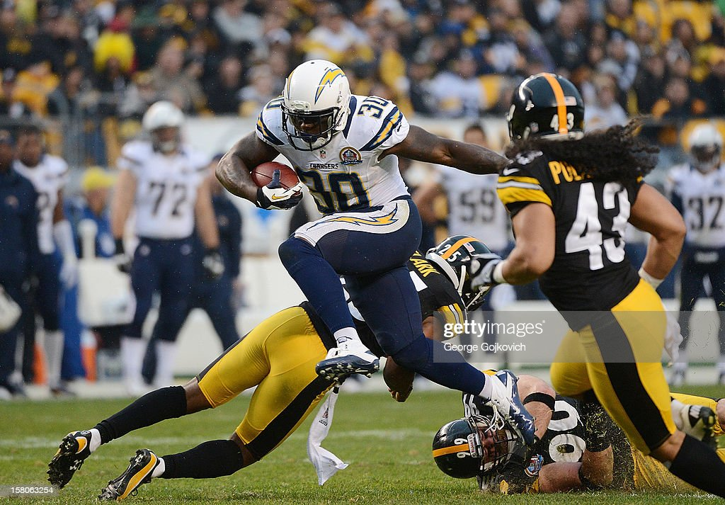 Running back Ronnie Brown #30 of the San Diego Chargers leaps in the air as he runs the football against safety Ryan Clark #25, defensive lineman Brett Keisel #99 and safety Troy Polamalu #43 of the Pittsburgh Steelers during a game at Heinz Field on December 9, 2012 in Pittsburgh, Pennsylvania. The Chargers defeated the Steelers 34-24.