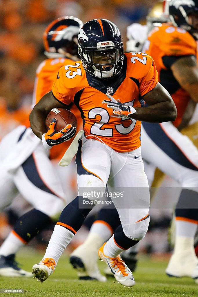 Running back Ronnie Hillman of the Denver Broncos carries the ball against the San Francisco 49ers during preseason action at Sports Authority Field...