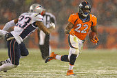 Running back Ronnie Hillman of the Denver Broncos carries the ball against strong safety Patrick Chung of the New England Patriots in the fourth...
