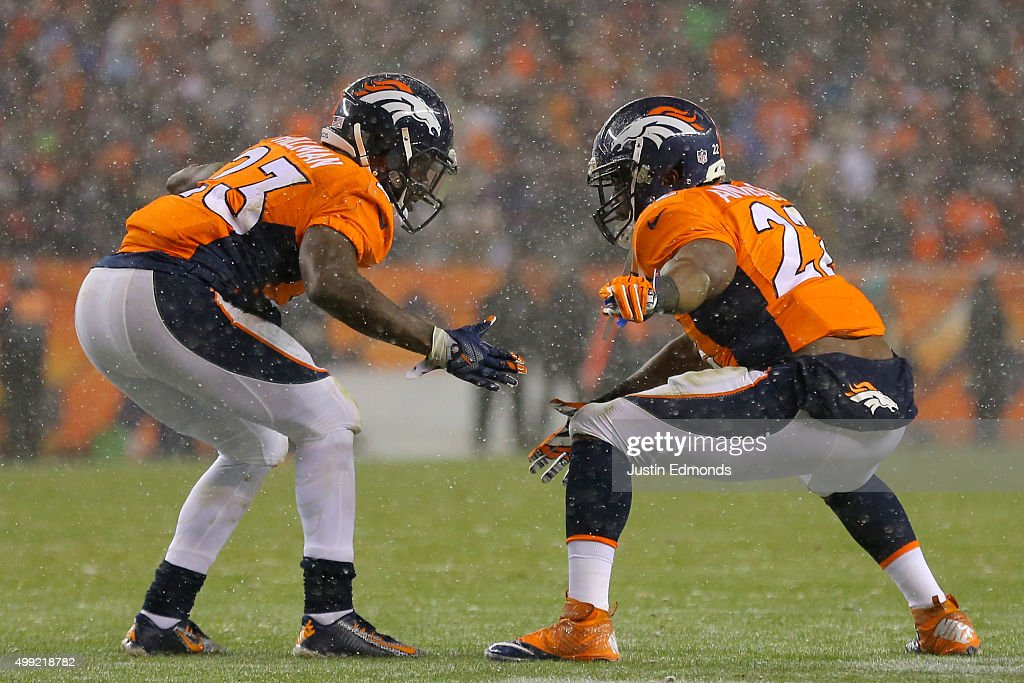 Running back Ronnie Hillman of the Denver Broncos celebrates with running back CJ Anderson of the Denver Broncos after scoring a second quarter...