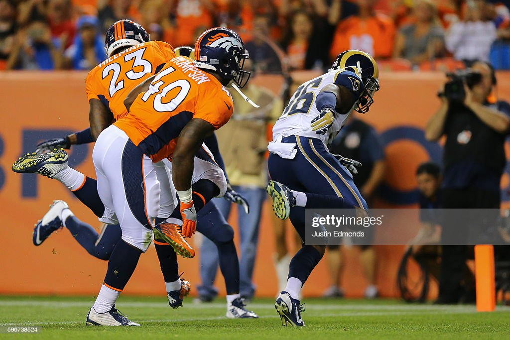 Running back Ronnie Hillman of the Denver Broncos crosses the goal line for a third quarter touchdown near Juwan Thompson and defensive back Rohan...