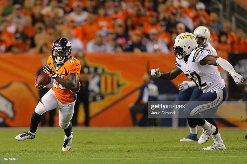 Running back Ronnie Hillman of the Denver Broncos has room to run against outside linebacker Reggie Walker of the San Diego Chargers in the first...