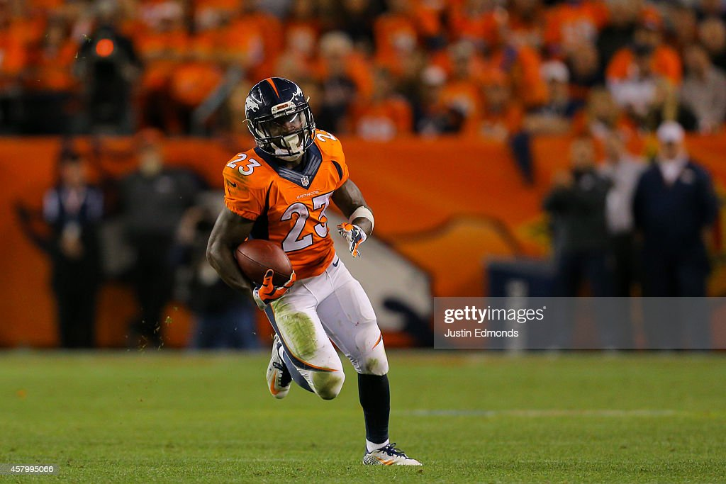 Running back Ronnie Hillman of the Denver Broncos runs with the football against the San Diego Chargers at Sports Authority Field at Mile High on...