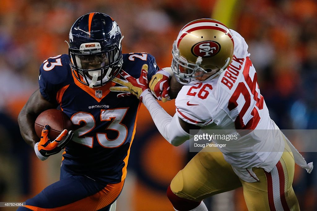 Running back Ronnie Hillman of the Denver Broncos rushes against cornerback Tramaine Brock of the San Francisco 49ers during a game at Sports...