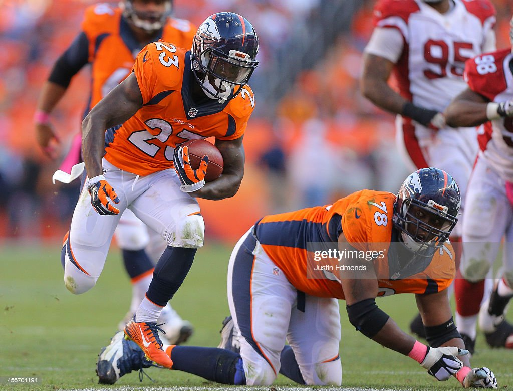 Running back <a gi-track='captionPersonalityLinkClicked' href=/galleries/search?phrase=Ronnie+Hillman&family=editorial&specificpeople=7355403 ng-click='$event.stopPropagation()'>Ronnie Hillman</a> #23 of the Denver Broncos rushes against the Arizona Cardinals during a game at Sports Authority Field at Mile High on October 5, 2014 in Denver, Colorado.
