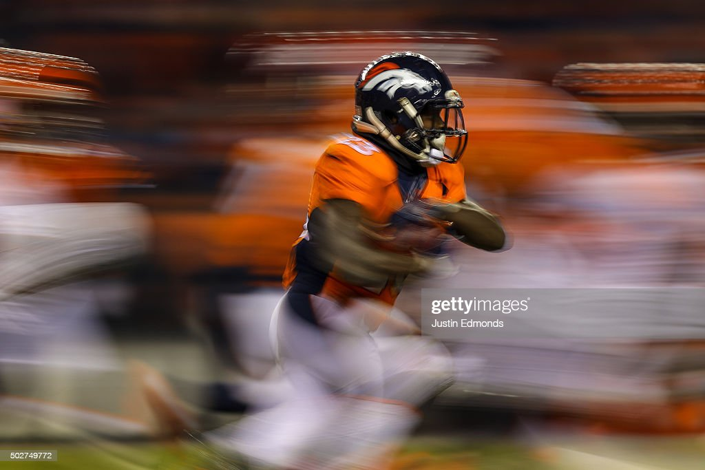Running back <a gi-track='captionPersonalityLinkClicked' href=/galleries/search?phrase=Ronnie+Hillman&family=editorial&specificpeople=7355403 ng-click='$event.stopPropagation()'>Ronnie Hillman</a> #23 of the Denver Broncos rushes against the Cincinnati Bengals during a game at Sports Authority Field at Mile High on December 28, 2015 in Denver, Colorado.