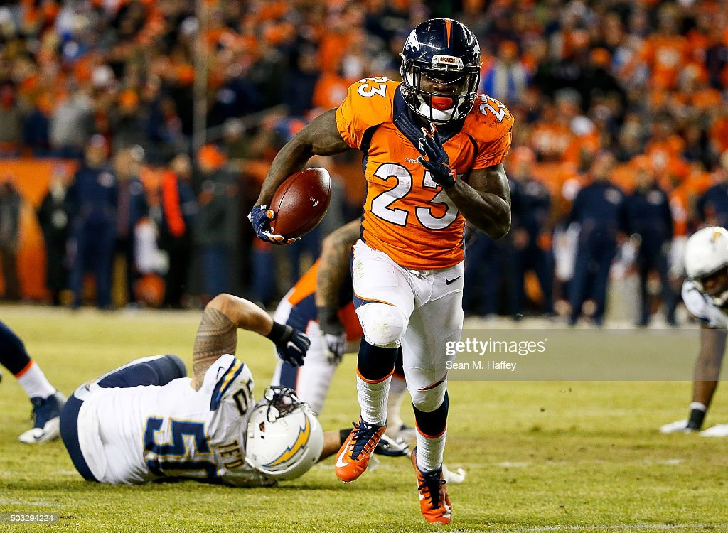 Running back Ronnie Hillman of the Denver Broncos rushes against the San Diego Chargers at Sports Authority Field at Mile High on January 3 2016 in...