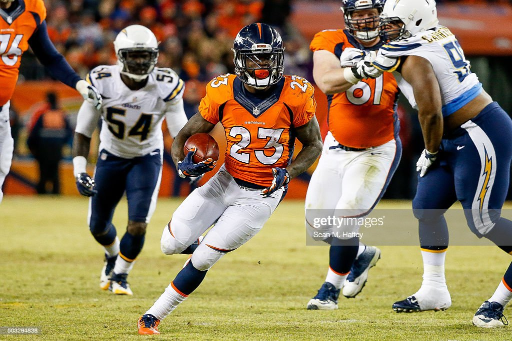 Running back Ronnie Hillman of the Denver Broncos rushes against the San Diego Chargers during a game at Sports Authority Field at Mile High on...