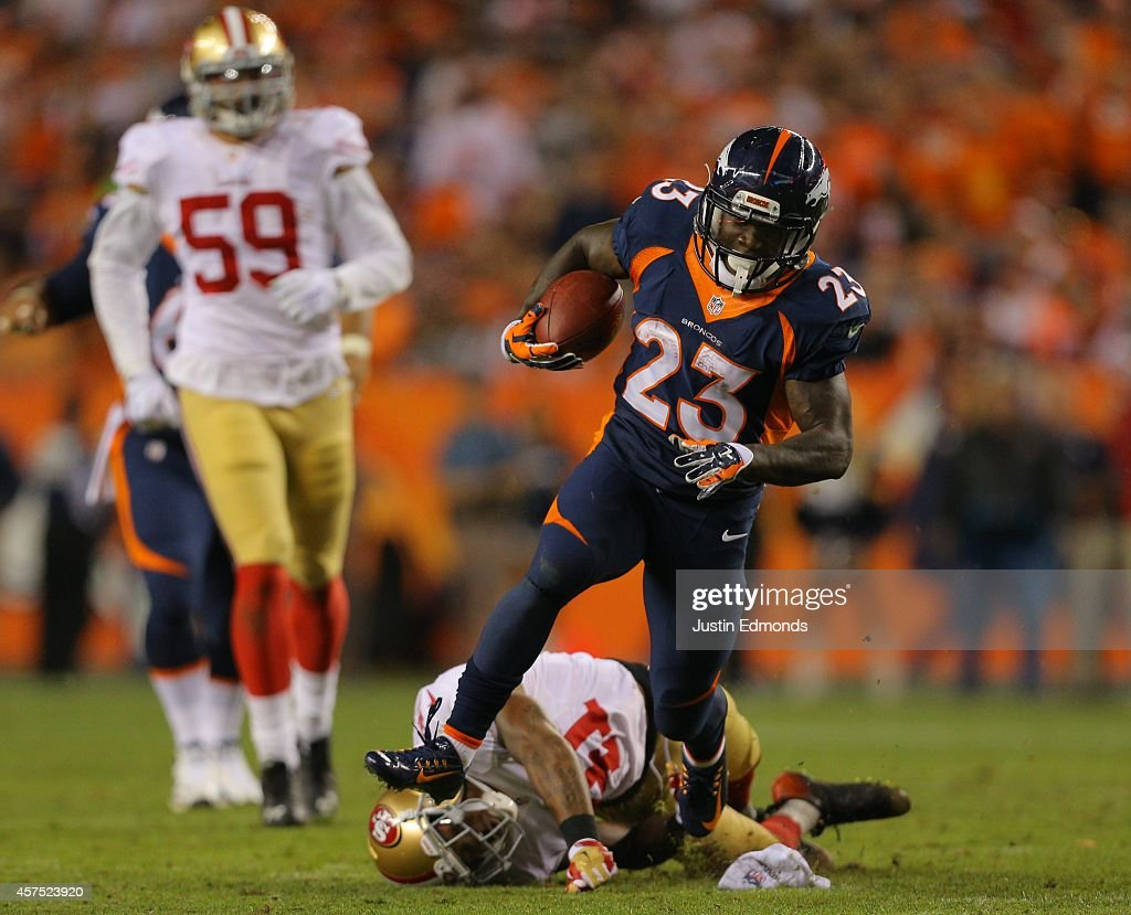 Running back <a gi-track='captionPersonalityLinkClicked' href=/galleries/search?phrase=Ronnie+Hillman&family=editorial&specificpeople=7355403 ng-click='$event.stopPropagation()'>Ronnie Hillman</a> #23 of the Denver Broncos rushes for a 37 yard 3rd quarter touchdown against the San Francisco 49ers at Sports Authority Field at Mile High on October 19, 2014 in Denver, Colorado.