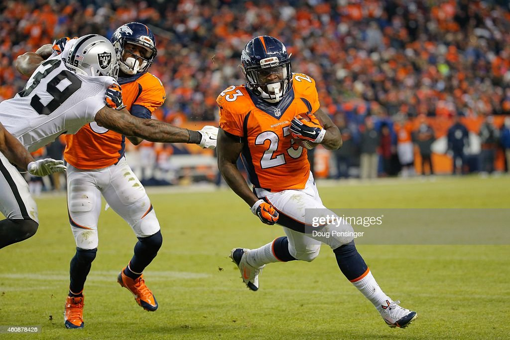 Running back Ronnie Hillman of the Denver Broncos rushes for a first down on a challenged spot during a game at Sports Authority Field at Mile High...