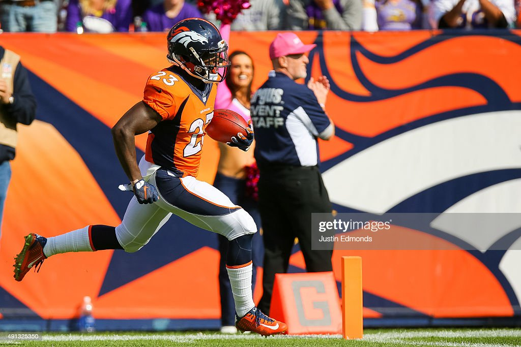 Running back <a gi-track='captionPersonalityLinkClicked' href=/galleries/search?phrase=Ronnie+Hillman&family=editorial&specificpeople=7355403 ng-click='$event.stopPropagation()'>Ronnie Hillman</a> #23 of the Denver Broncos scores a touchdown on an 72 yard rush in the second quarter of a game against the Minnesota Vikings at Sports Authority Field at Mile High on October 4, 2015 in Denver, Colorado.
