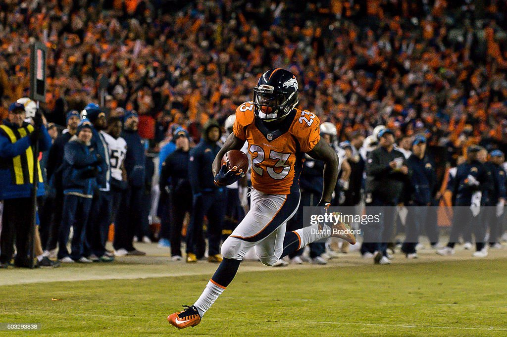 Running back <a gi-track='captionPersonalityLinkClicked' href=/galleries/search?phrase=Ronnie+Hillman&family=editorial&specificpeople=7355403 ng-click='$event.stopPropagation()'>Ronnie Hillman</a> #23 of the Denver Broncos scores a touchdown on a 23-yard rush in the fourth quarter of a game against the San Diego Chargers at Sports Authority Field at Mile High on January 3, 2016 in Denver, Colorado.