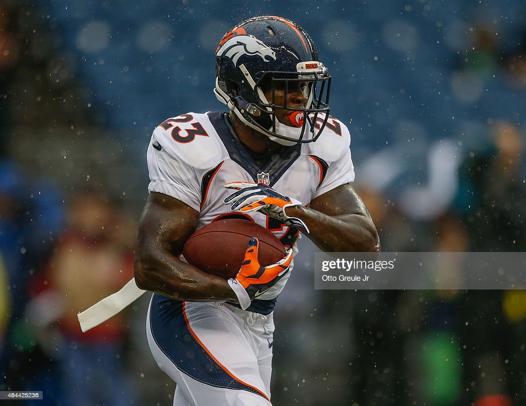 Running back <a gi-track='captionPersonalityLinkClicked' href=/galleries/search?phrase=Ronnie+Hillman&family=editorial&specificpeople=7355403 ng-click='$event.stopPropagation()'>Ronnie Hillman</a> #23 of the Denver Broncos warms up prior to the game against the Seattle Seahawks at CenturyLink Field on August 14, 2015 in Seattle, Washington.