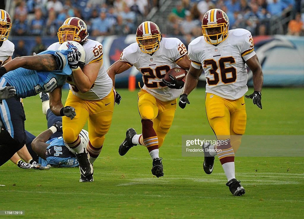 Running back <a gi-track='captionPersonalityLinkClicked' href=/galleries/search?phrase=Roy+Helu&family=editorial&specificpeople=4547489 ng-click='$event.stopPropagation()'>Roy Helu</a> #29 of the Washington Redskins runs behind teammate Darrel Young #36 against the Tennessee Titans during a pre-season game at LP Field on August 8, 2013 in Nashville, Tennessee.