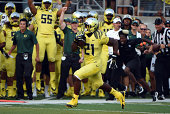 Running back Royce Freeman of the Oregon Ducks heads for the endzone and a touchdown during the fourth quarter of the game at Autzen Stadium on...