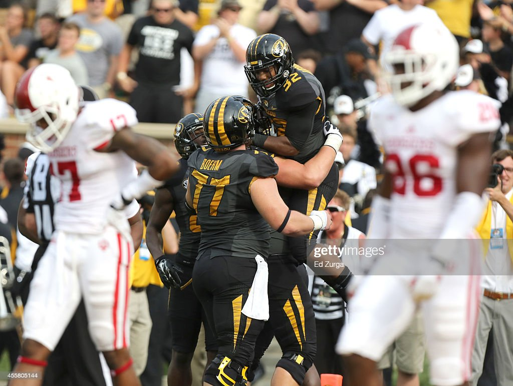 Running back Russell Hansbrough #32 of the Missouri Tigers celebrates his touchdown run with <a gi-track='captionPersonalityLinkClicked' href=/galleries/search?phrase=Evan+Boehm&family=editorial&specificpeople=9839229 ng-click='$event.stopPropagation()'>Evan Boehm</a> #77 in the second quarter during a game against the Indiana Hoosiers at Memorial Stadium on September 20, 2014 in Columbia, Missouri.