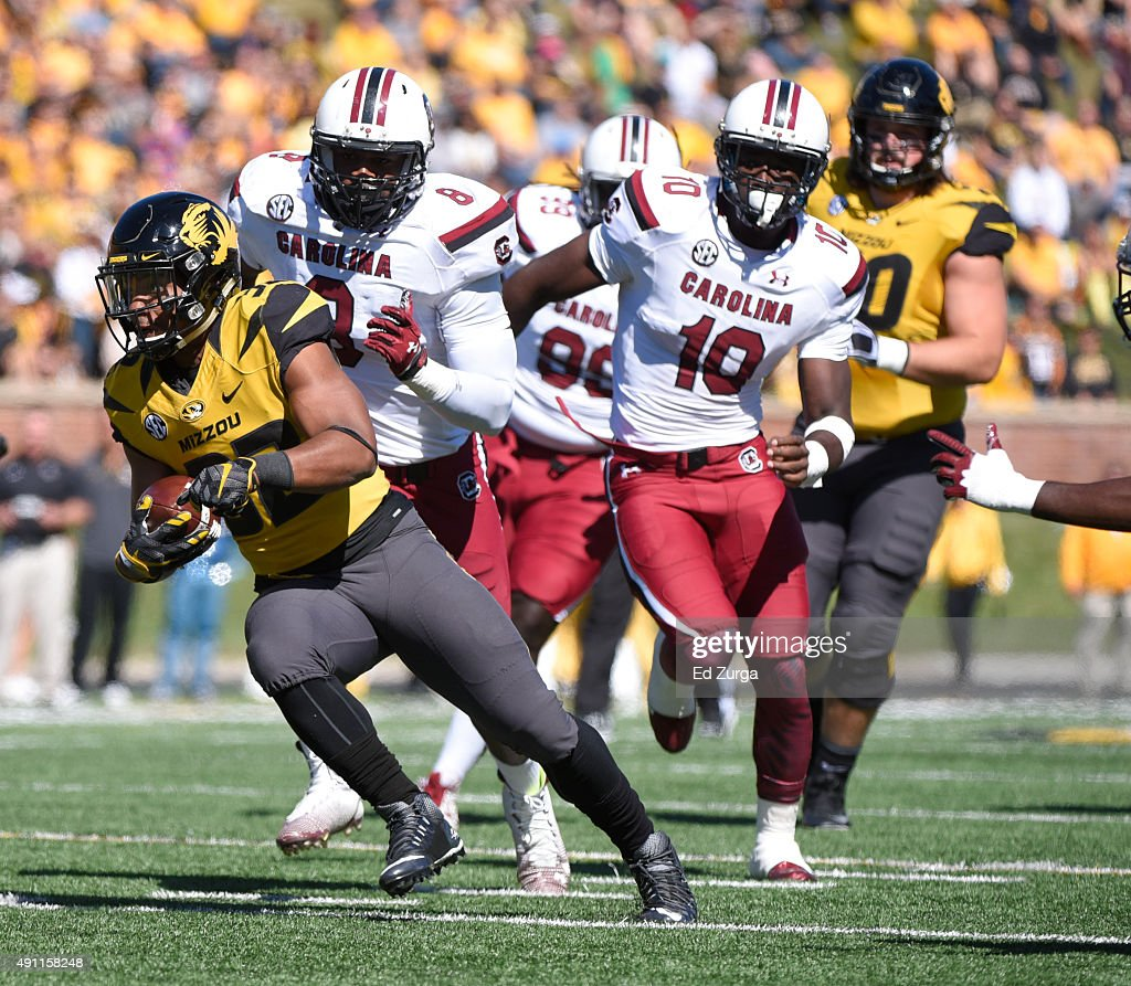 Running back Russell Hansbrough #32 of the Missouri Tigers finds running room against the South Carolina Gamecocks in the second quarter at Memorial Stadium on October 3, 2015 in Columbia, Missouri.
