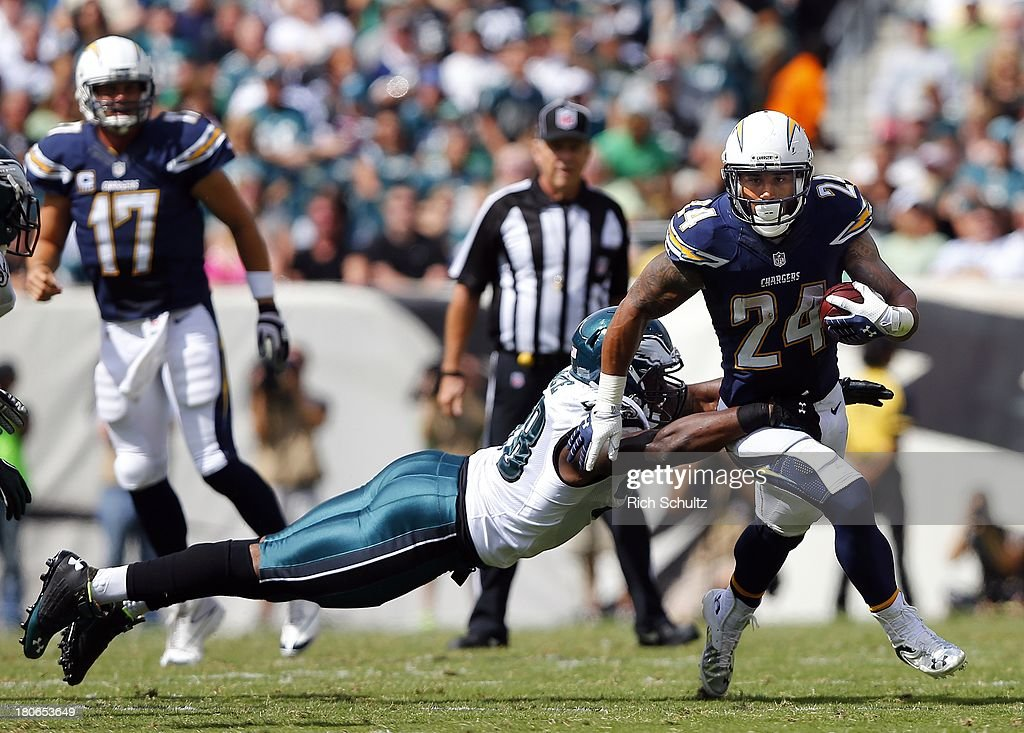 Running back <a gi-track='captionPersonalityLinkClicked' href=/galleries/search?phrase=Ryan+Mathews+-+American+Football+Player&family=editorial&specificpeople=2082832 ng-click='$event.stopPropagation()'>Ryan Mathews</a> #24 attempts to elude defensive end <a gi-track='captionPersonalityLinkClicked' href=/galleries/search?phrase=Trent+Cole&family=editorial&specificpeople=763574 ng-click='$event.stopPropagation()'>Trent Cole</a> #58 of the Philadelphia Eagles during the first half in a game at Lincoln Financial Field on September 15, 2013 in Philadelphia, Pennsylvania. The Chargers defeated the Eagles 33-3.