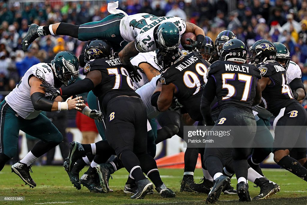 Running back Ryan Mathews #24 of the Philadelphia Eagles scores a two point conversion over top of defensive tackle Michael Pierce #78 and nose tackle Brandon Williams #98 of the Baltimore Ravens in the second quarter at M&T Bank Stadium on December 18, 2016 in Baltimore, Maryland.