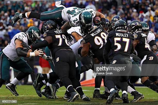 Running back Ryan Mathews of the Philadelphia Eagles scores a two point conversion over top of defensive tackle Michael Pierce and nose tackle...