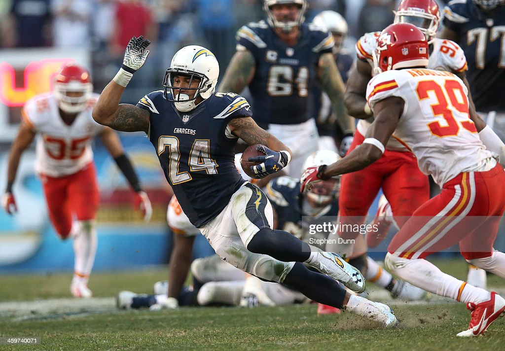 Running back <a gi-track='captionPersonalityLinkClicked' href=/galleries/search?phrase=Ryan+Mathews+-+American+Football+Player&family=editorial&specificpeople=2082832 ng-click='$event.stopPropagation()'>Ryan Mathews</a> #2 of the San Diego Chargers carries the ball in overtime against the Kansas City Chiefs at Qualcomm Stadium on December 29, 2013 in San Diego, California. The Chargers won 27-2 in overtime.
