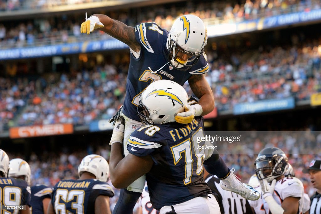Running back <a gi-track='captionPersonalityLinkClicked' href=/galleries/search?phrase=Ryan+Mathews+-+American+Football+Player&family=editorial&specificpeople=2082832 ng-click='$event.stopPropagation()'>Ryan Mathews</a> #24 of the San Diego Chargers celebrates his touchdown with offensive tackle <a gi-track='captionPersonalityLinkClicked' href=/galleries/search?phrase=D.J.+Fluker&family=editorial&specificpeople=7188344 ng-click='$event.stopPropagation()'>D.J. Fluker</a> #76 in the 4th quarter at Qualcomm Stadium November 10, 2013 San Diego, CA.