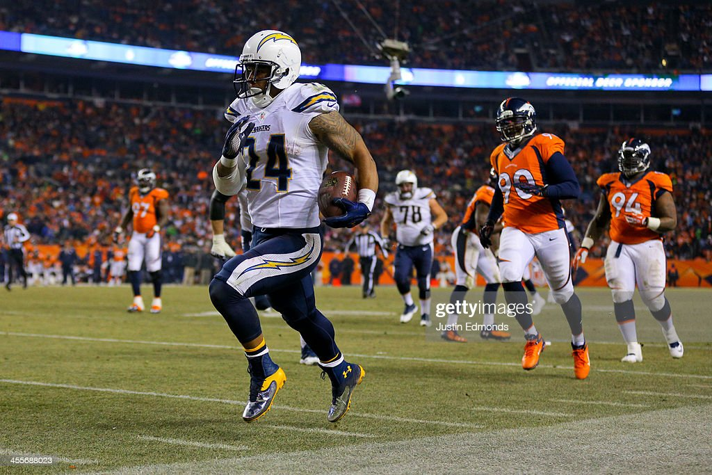 Running back <a gi-track='captionPersonalityLinkClicked' href=/galleries/search?phrase=Ryan+Mathews+-+American+Football+Player&family=editorial&specificpeople=2082832 ng-click='$event.stopPropagation()'>Ryan Mathews</a> #24 of the San Diego Chargers runs for a 23-yard touchdown during the third quarter against the Denver Broncos at Sports Authority Field Field at Mile High on December 12, 2013 in Denver, Colorado. The Chargers defeated the Broncos 27-20.
