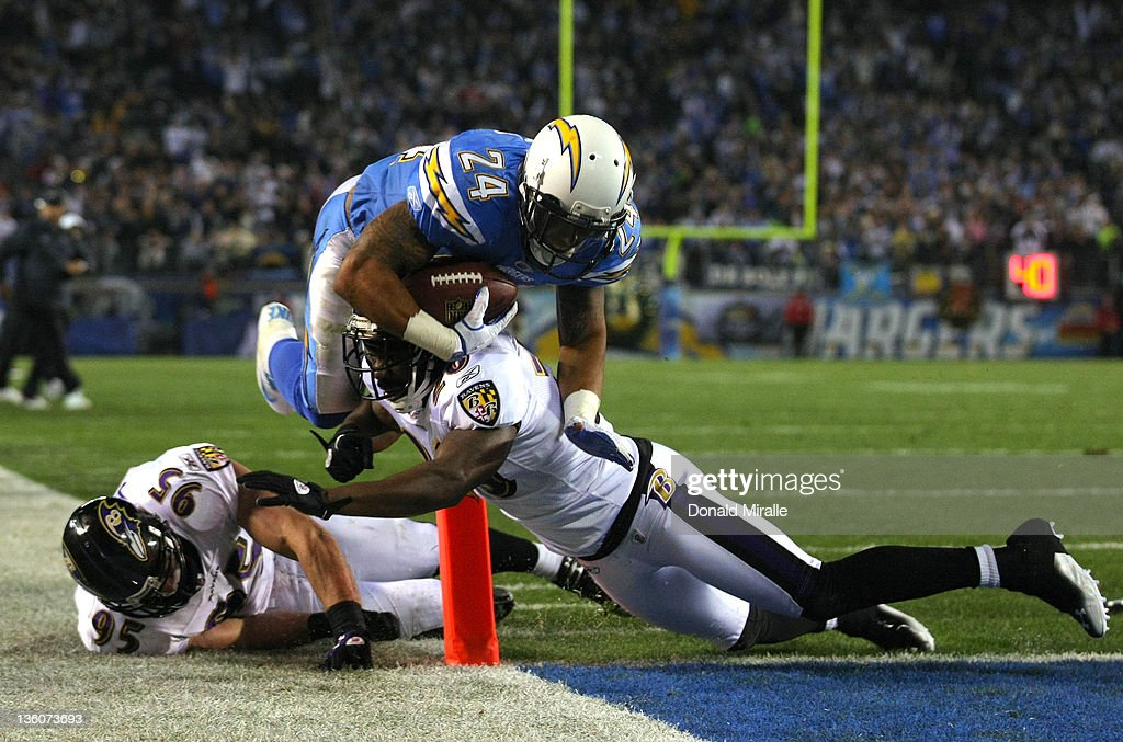 Running back Ryan Mathews #24 of the San Diego Chargers runs through tackles for a touchdown against the Baltimore Ravens during their NFL Game on December 18, 2011 at Qualcomm Stadium in San Diego, California.