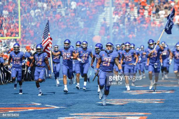 Running back Ryan Wolpin of the Boise State Broncos carries the hammer and leads the Broncos into the stadium prior to that start of first half...