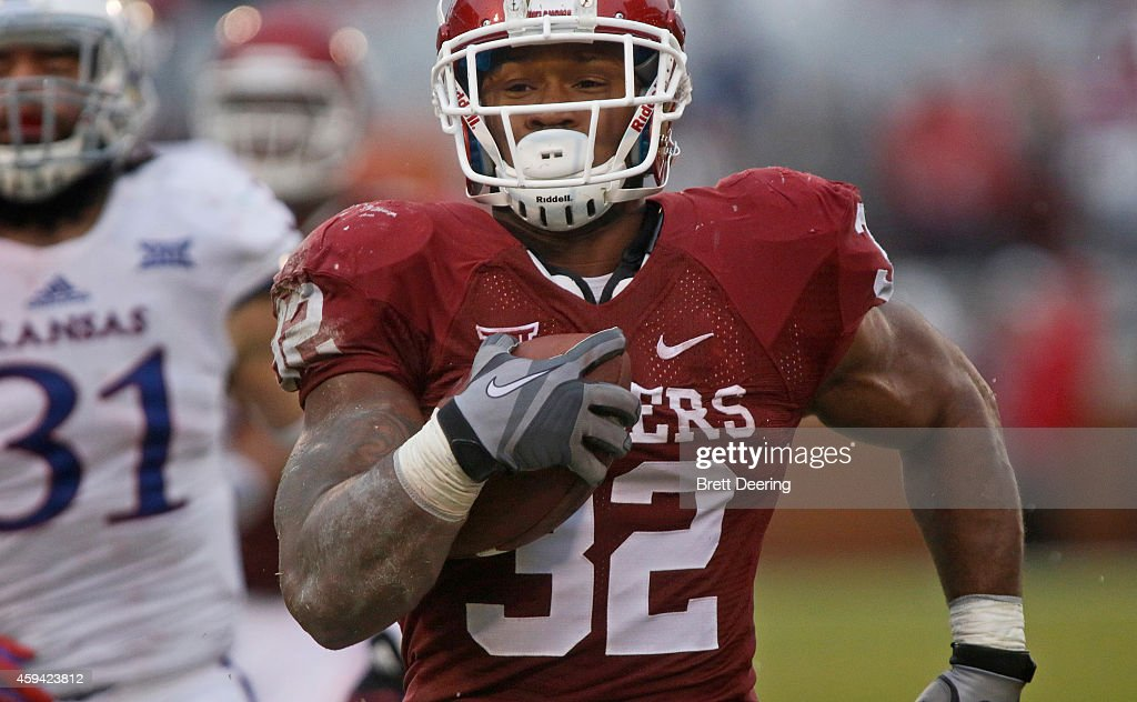 Running back Samaje Perine #32 of the Oklahoma Sooners breaks away from the Kansas Jayhawks to score November 22, 2014 at Gaylord Family-Oklahoma Memorial Stadium in Norman, Oklahoma.