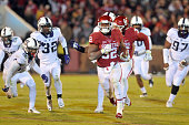 Running back Samaje Perine of the Oklahoma Sooners runs for a second half touchdown past cornerback Nick Orr and linebacker Travin Howard of the TCU...