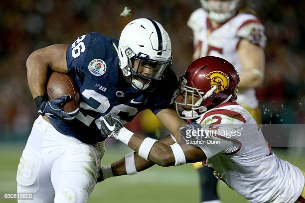 Running back Saquon Barkley of the Penn State Nittany Lions carries the ball against defensive back Adoree' Jackson of the USC Trojans in the second...