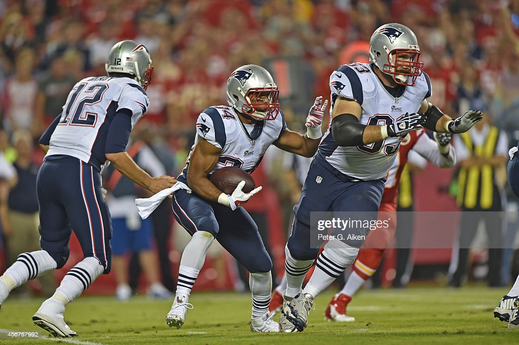 Running back Shane Vereen of the New England Patriots runs behind linemen Dan Connolly during the first half against of the Kansas City Chiefs on...