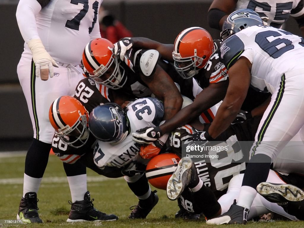 Running back Shaun Alexander #37 of the Seattle Seahawks is gang-tackled by Sean Jones #26, Kamerion Wimbley #95, Leon Williams #94, and Robaire Smith #98 of the Cleveland Browns during a game on November 4, 2007 at Cleveland Browns Stadium in Cleveland, Ohio. Cleveland won 33-30 in overtime. Shaun Alexander07-1223543