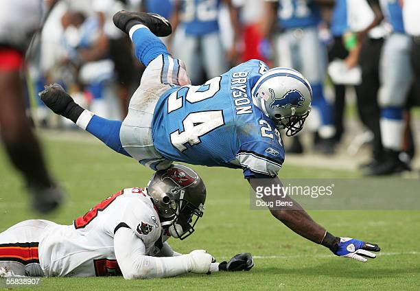 Running back Shawn Bryson of the Detroit Lions is tripped up by safety Jermaine Phillips of the Tampa Bay Buccaneers in the fourth quarter October 2...
