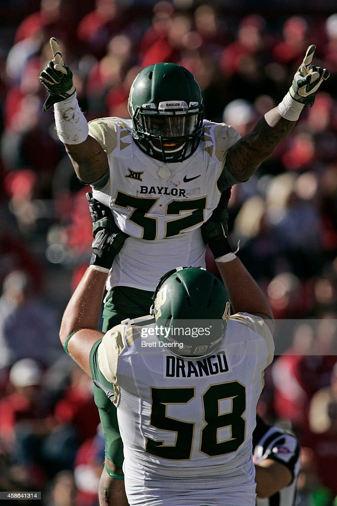 Running back Shock Linwood and offensive tackle Spencer Drango of the Baylor Bears celebrate a touchdown against the Oklahoma Sooners November 8 2014...