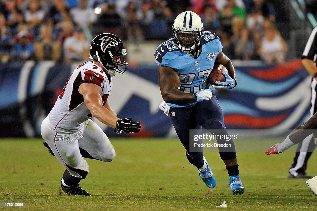 Running back Shonn Greene #23 of the Tennessee Titans plays during a pre-season game against Kroy Biermann #71 of the Atlanta Falcons at LP Field on August 24, 2013 in Nashville, Tennessee.
