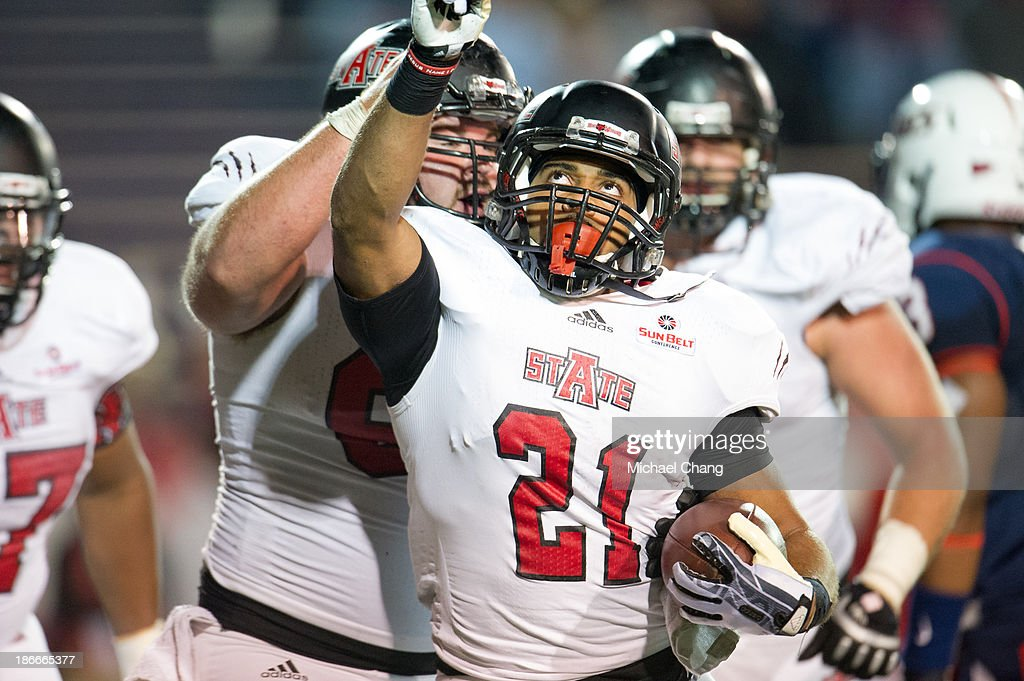 Running back Sirgregory Thornton #21 of the Arkansas State Red Wolves celebrates after scoring a touchdown during their game against the South Alabama Jaguars on November 2, 2013 at Ladd-Peebles Stadium in Mobile, Alabama. Arkansas State defeated South Alabama 17-16.