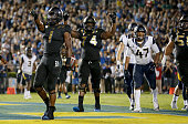 Running back Soso Jamabo of the UCLA Bruins and offensive lineman Caleb Benenoch of the UCLA Bruins react turnover a touchdown during the third...
