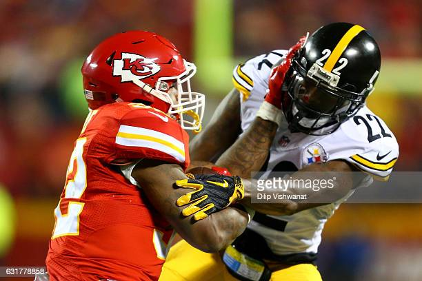 Running back Spencer Ware of the Kansas City Chiefs collides with cornerback William Gay of the Pittsburgh Steelers in the AFC Divisional Playoff...