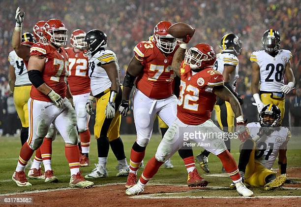 Running back Spencer Ware of the Kansas City Chiefs spikes the ball after a touchdown run against Pittsburgh Steelers during the second half in the...