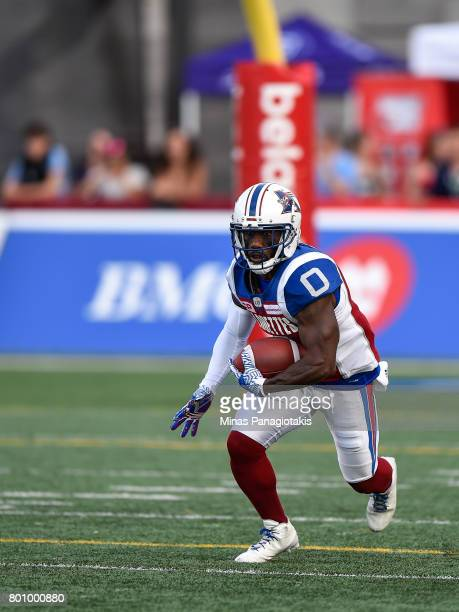 Running back Stefan Logan of the Montreal Alouettes runs with the ball during the CFL game against the Saskatchewan Roughriders at Percival Molson...